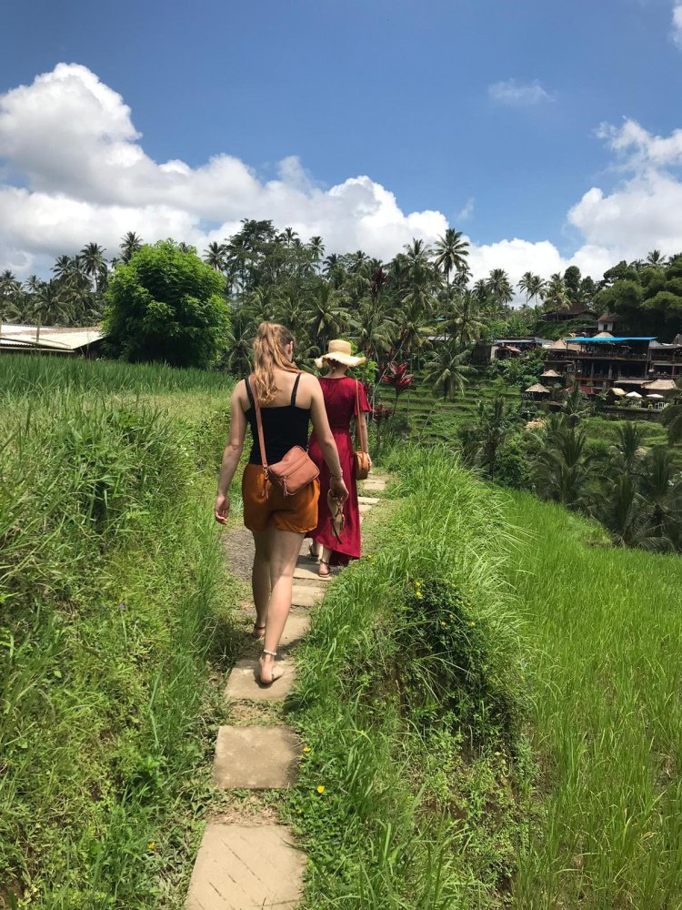 Walking along the Tegalalang rice terrace in Bali